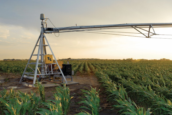 Center pivot irrigation system | Sunset field image | Agriculture watering system
